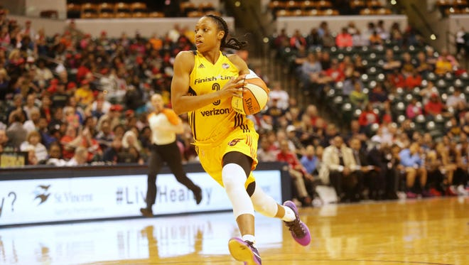 The Indiana Fever's Tiffany Mitchell grabs a loose ball and heads for the hoop as the Indiana Fever play the Atlanta Dream at Bankers Life Fieldhouse, Friday May 20th, 2016. The Fever beat the Dream 94 to 85.