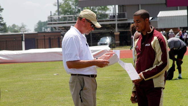 Malone (left) is the second-longest tenured track and field coach in ULM history behind Bob Groseclose and has produced 53 conference champions and 50 national qualifiers.