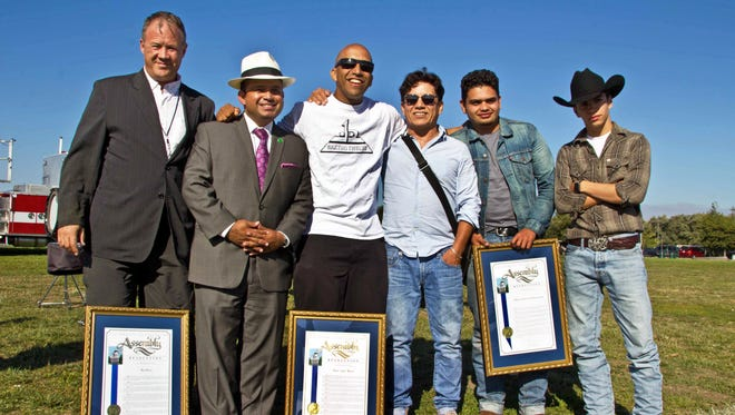 "From left, Salinas Californian photojournalist Jay Dunn, California State Assemblymember Luis Alejo, D-Watsonville, playwright Luis ""Xago"" Juarez of Baktun 12, artist JosŽé Ortiz, founder of Hijos del Sol, and colleagues JosŽé Nolasco and JosuŽé David Rubio at National Night Out in Salinas on Tuesday, August 2nd, 2016. During a ceremony at the event, Alejo awarded photographer Dunn, playwright Juarez and artists Hijos del Sol the 2016 California Peace Award."