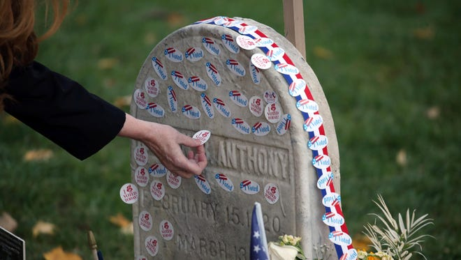 "In 2016, voters lined up on election day to place ""I voted"" stickers on the grave of Susan B. Anthony at Mt. Hope Cemetery."