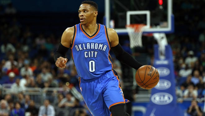 Oklahoma City Thunder guard Russell Westbrook (0) drives to the basket against the Orlando Magic during the first quarter at Amway Center.