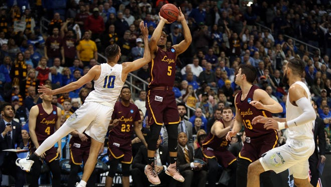 Loyola guard Marques Townes (5) makes a three-point shot against Nevada on Thursday.