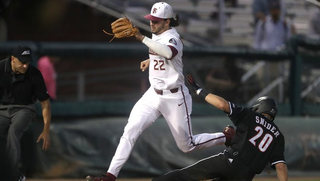 FSU's Drew Mendoza tags third base for the out before Louisville's Jake Snider slides in during the Seminoles' 9-4 win at Dick Howser Stadium on Thursday.