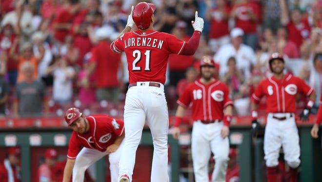 Reds pitcher Michael Lorenzen points skyward after his pinch-hit grand slam in the 7th.