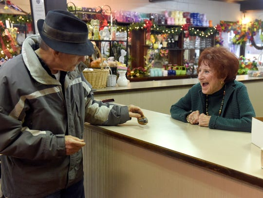 Business owner Joan Schmitt, 90, jokes with long-time