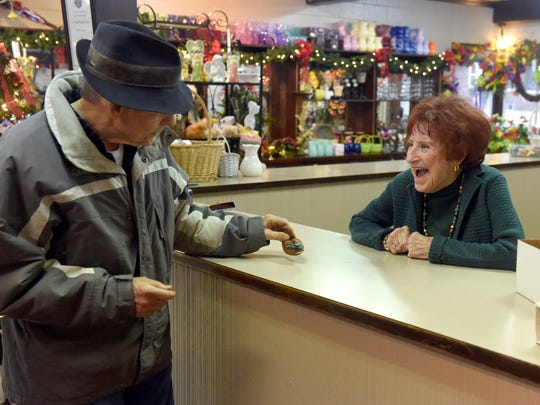 Business owner Joan Schmitt, 90, jokes with long-time customer Wayne Kinch of Evansville while working at The Flower Shop on Kentucky Avenue in Evansville Friday.  Schmitt is retiring after running the family owned business that has been at the same location for 140 years.  All items at the shop have been heavily discounted and the historic business is expected to close at the end of January.