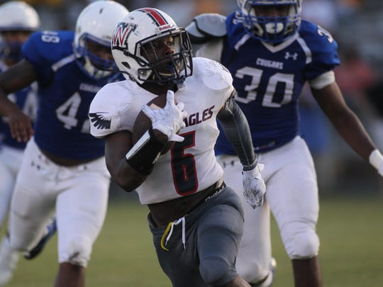 Left: Wakulla running back Cephus Greene picks up a chunk of yardage during a half against Godby in Friday's spring jamboree at Gene Cox Stadium.