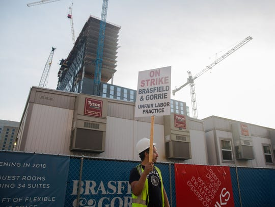 Omni Hotel construction worker, Bernardo Valdez, protests