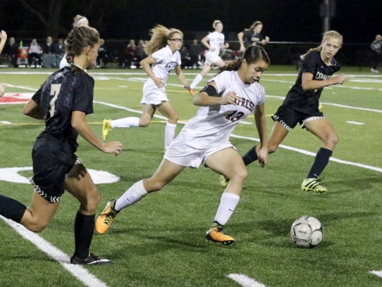 Elmira's Kendra Oldroyd dribbles the ball up the field