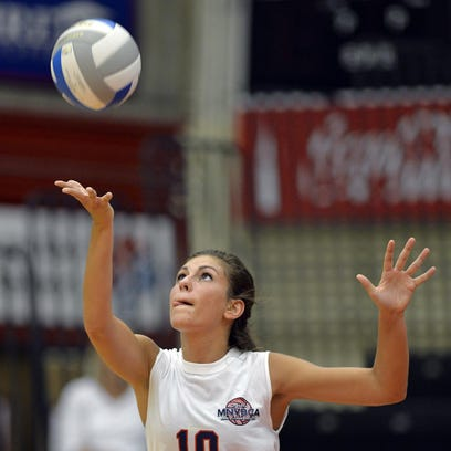 Rocori's Morgan Koshiol (3) of the red team spikes the ball in the second game against the white team during the 2015 MNVBCA All-Star Match on Wednesday night at Halenbeck Hall.
