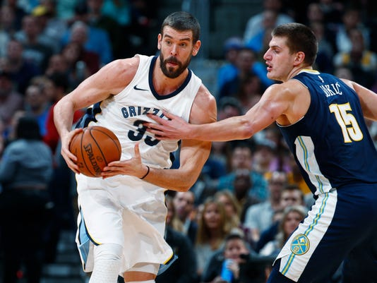 Memphis Grizzlies center Marc Gasol, left, of Spain, pulls in a loose ball as Denver Nuggets center Nikola Jokic, of Serbia, defends in the first half of an NBA basketball game Friday, Nov. 24, 2017, in Denver. (AP Photo/David Zalubowski)