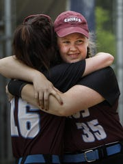 Okemos pitcher Sally Patterson, right, shares a moment with a teammate after leading her Chiefs to a 3-1 Div. 1 District Championship June 4, 2016, in East Lansing.