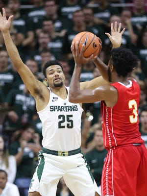 MSU's Kenny Goins defends Ferris State's Markese Mayfield in an exhibition Oct. 26 at Breslin Center.