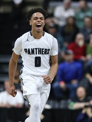 Xavier Wade celebrates the 53-50 win over Novi on Friday.