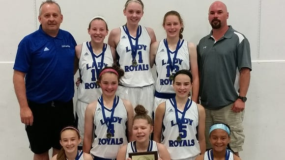 The Western North Carolina Royals seventh-grade basketball team and coaches.