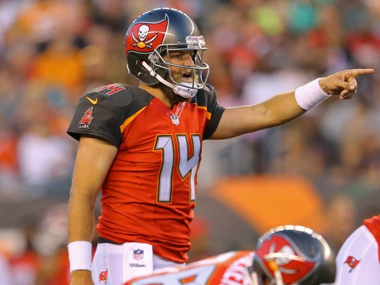 Tampa Bay Buccaneers quarterback Ryan Fitzpatrick (14) points against the Cincinnati Bengals in the first half at Paul Brown Stadium.