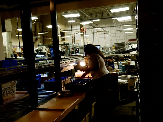 A shipping agent prepares shipments during a tour of
