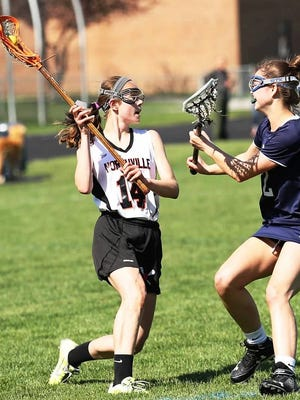 Northville freshman Charlotte Beaudoin (left) was a defensive catalyst in a 12-7 win Thursday over Brighton.