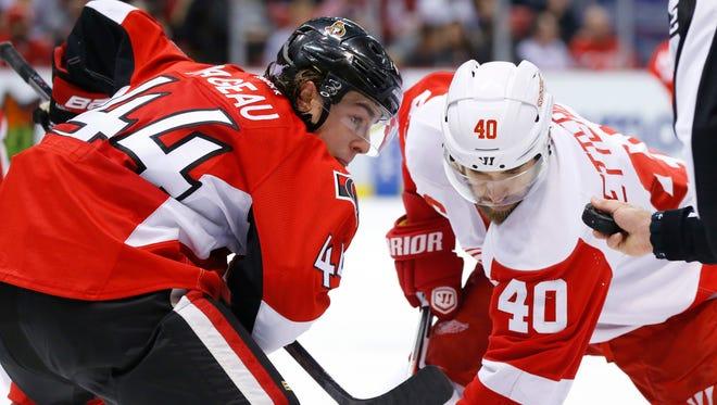 Ottawa Senators center Jean-Gabriel Pageau, left, and the Detroit Red Wings' Henrik Zetterberg face off Oct. 30, 2015, in Detroit.