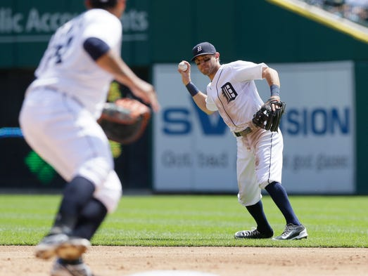 Detroit Tigers second baseman Ian Kinsler throws to first baseman Miguel Cabrera for the out on Pittsburgh Pirates' Gregory Polanco during the sixth inning of an interleague baseball game, Thursday, Aug. 14, 2014 in Detroit.