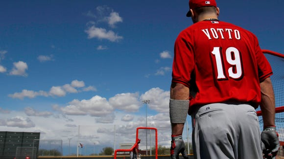 Reds first baseman Joey Votto observes batting practice