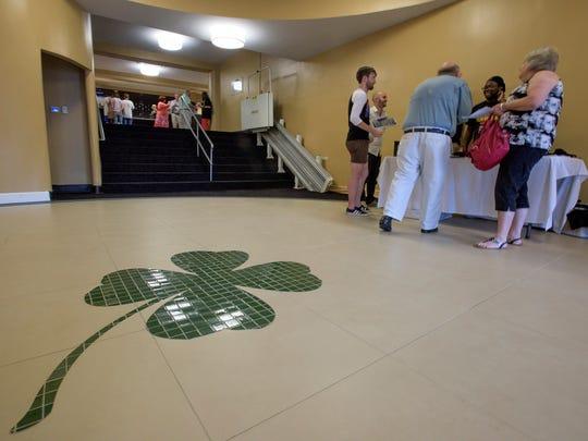 The clover on the floor in the Capri Theatre's lobby.