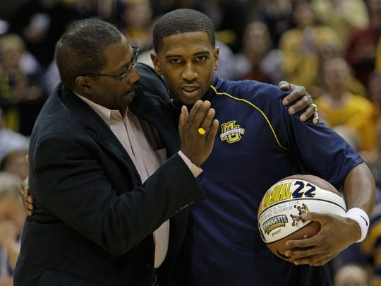 George Thompson (left) congratulates Jerel McNeal for overtaking him as Marquette's all-time leading scorer in 2009.