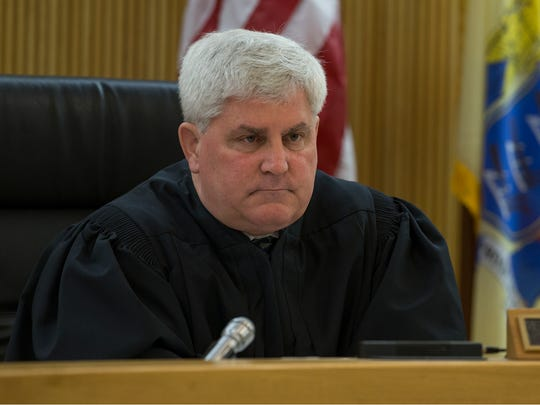"Judge Joseph W. Oxley presides.  Former Asbury Park police officer Keith German is sentenced to 10 years in prison without parole in the ""Operation Dead End"" case.  