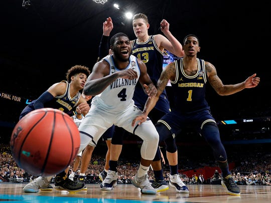 Villanova's Eric Paschall (4) reacts as he loses control