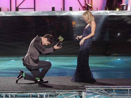 Darren Criss presents an award to Kristin Chenoweth onstage at Logo TV's 2014 NewNowNext Awards at the Kimpton Surfcomber Hotel on December 2, 2014 in Miami Beach, Florida.