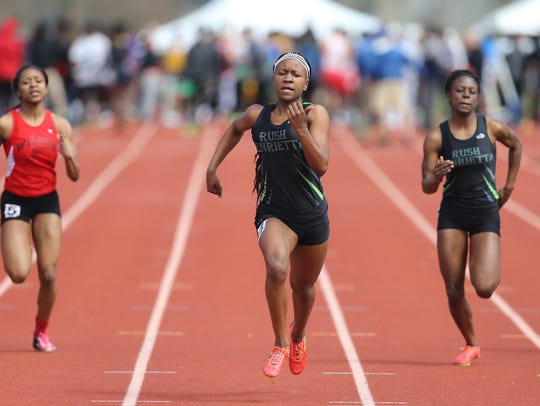 Rush-Henrietta's Lanae-Tava Thomas wins the 100-meter