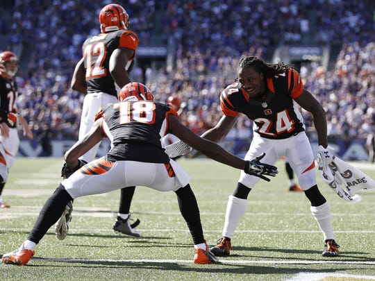 Cincinnati Bengals wide receiver A.J. Green (18) is congratulated by teammate cornerback Adam Jones (24) after his touchdown against the Baltimore Ravens  in Baltimore.