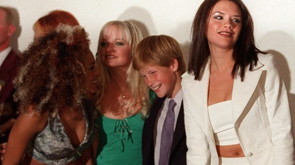 Prince Harry laughs with the Spice Girls, including