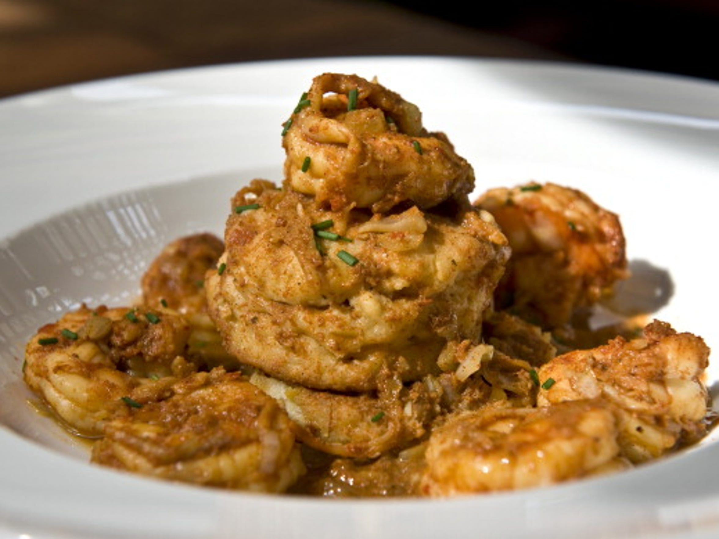 New Orleans-Style Barbecued Shrimp, made in the oven, easily serves a crowd. Pass around plenty of bread to soak up the sauce.