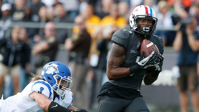 Purdue Boilermakers wide receiver DeAngelo Yancey (7) catches a pass for a touchdown against Indiana State Sycamores defensive back Tsali Lough (3) at Ross Ade Stadium.