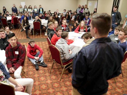 A crowd listens as Jack Loken, a student at Xavier High School, speaks as part of a panel during the United Way Fox Cities' Teen Symposium on Monday at the Radisson Paper Valley Hotel in Appleton. Wm. Glasheen/USA TODAY NETWORK-Wisconsin.