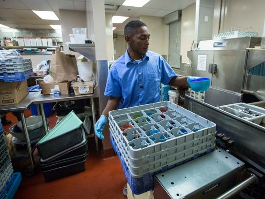 Charles Jones works in the kitchen at the Central Iowa