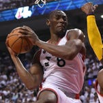 Toronto Raptors center Bismack Biyombo grabs one of his record-tying 26 rebounds in Game 3 against Cleveland.