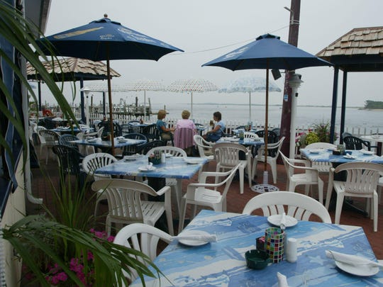 Inlet Cafe in Highlands has a back patio overlooking the nearby water. Guests can enjoy a casual environment as they watch boats go by.