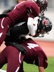 Anson wide receiver Ethan Baccus (center) is pulled