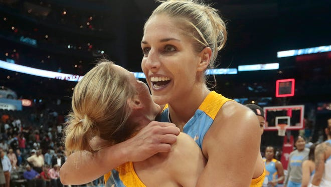 Elena Delle Donne celebrates with teammate Allie Quigley.