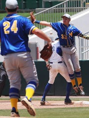 In a wild pick-off attempt at first base, John Carroll
