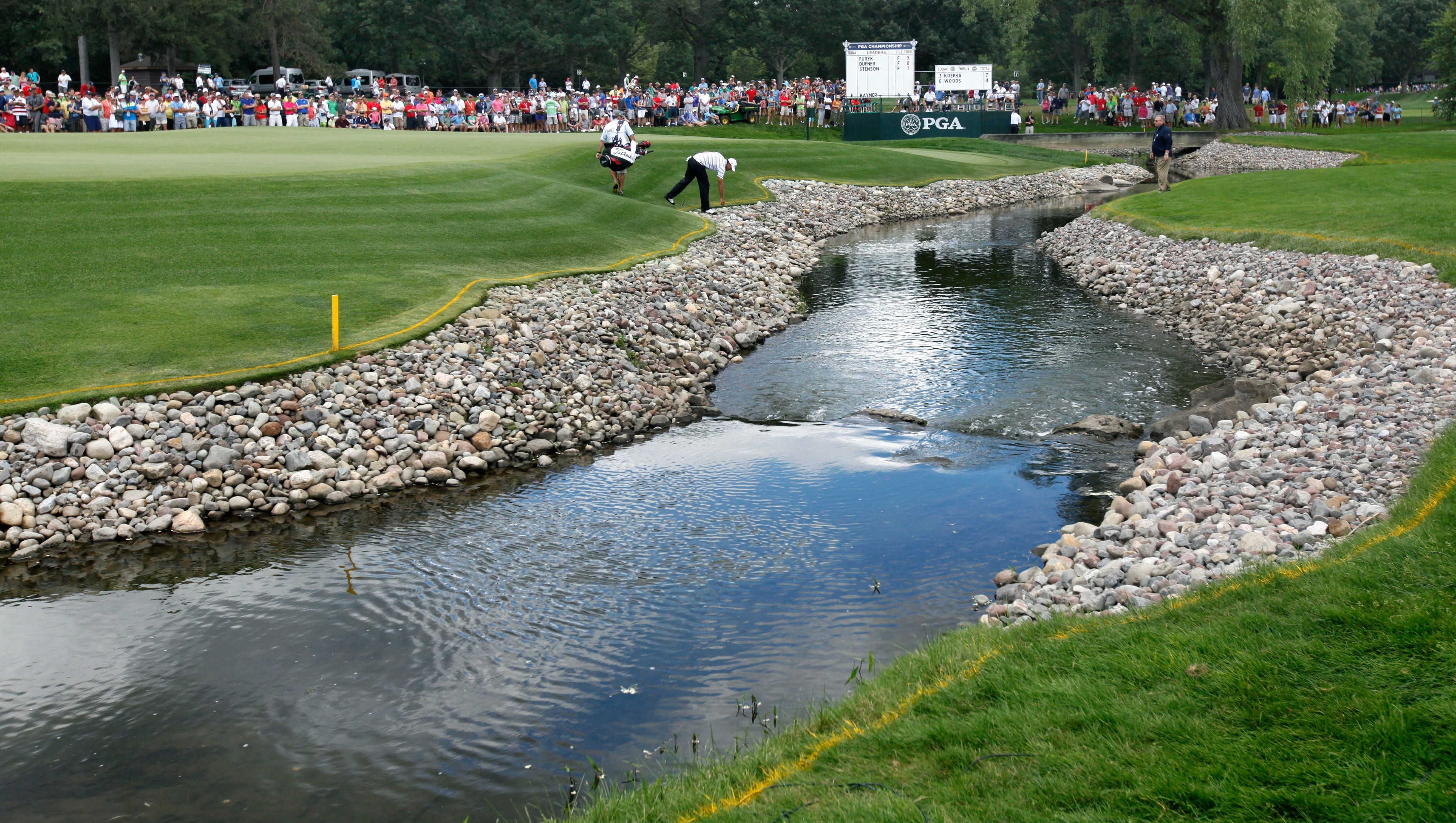 Brook Koepka's ball fell on the rocks before the water on 5 during the final round of the 95th PGA championship at Oak Hill Country Club.
