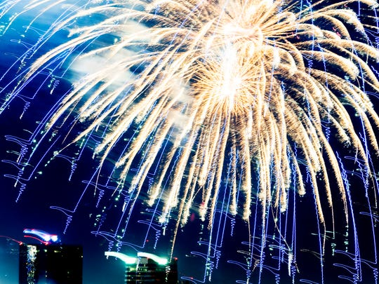 Fireworks burst over the downtown Knoxville skyline during the annual Festival on the Fourth fireworks display in Knoxville, Tennessee on Wednesday, July 4, 2018.
