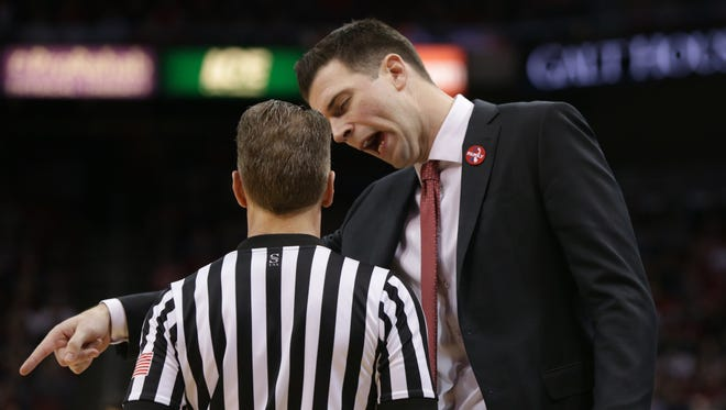 Louisville interim coach David Padgett disagreed with a a call that went against his during during second half action against Syracuse. Feb. 5, 2018.