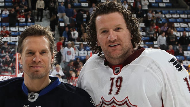 Kimmo Timonen and Scott Hartnell were teammates for 953 of Hartnell's 1,000 NHL games.