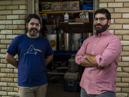 Hunter Hebert and Daniel Amire, who homebrew under the moniker Hub City Beerworks, pose for a photograph with their brewing equipment in the garage at Hebert's home in Lafayette, LA, Thursday, Aug. 20, 2015.