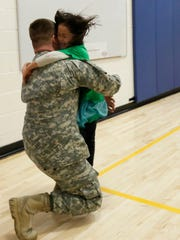 Kindergartener Bianca Withers runs to embrace her father, U.S. Army Staff Sgt. Joshua Withers, during a surprise reunion on Friday morning at Thomas Jefferson Elementary School.