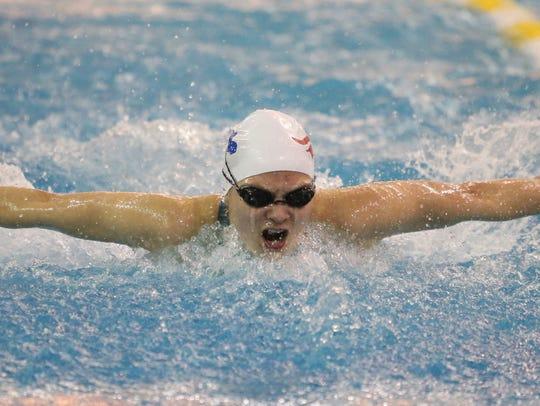 Newark Charter's Gretchen Fruehstorfer swims the butterfly