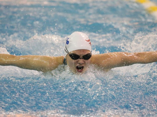 Newark Charter's Gretchen Fruehstorfer swims the butterfly leg of her team's winning 200 yard medley relay during the DIAA state high school girls swimming and diving championships Saturday at the University of Delaware.